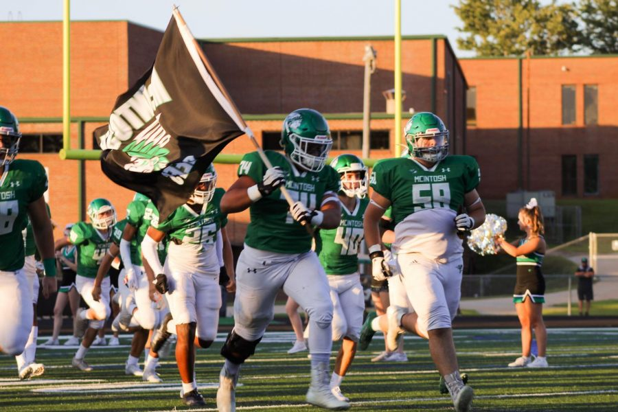 The McIntosh Chiefs take the field just prior to the beginning of the game.