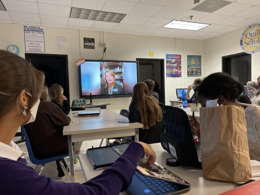 Students in Yearbook watching the announcement made by Mrs. Walls regarding the vandalism going on around school.  Photo by Tracy Guo